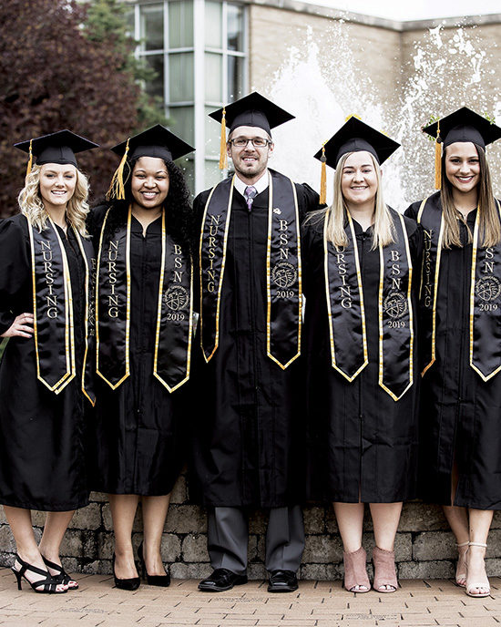 PNW graduates pose at commencement