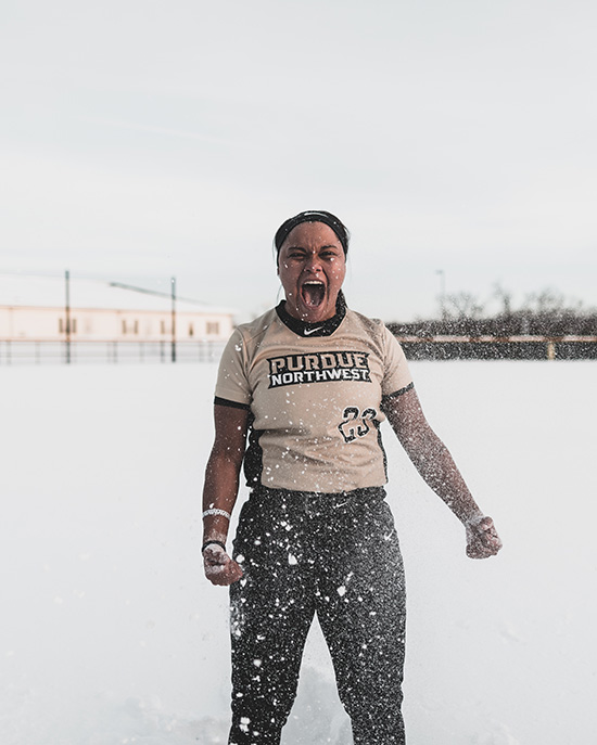PNW softball player Kyleigh Payne celebrates in the snow