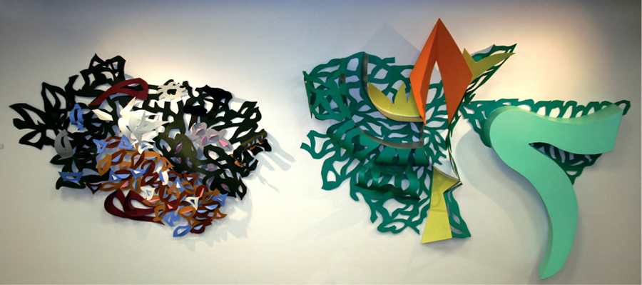 Sculpture: A Green Field – George Sugarman Painted aluminum. A multi-colored work composed of two separate sections of cutouts; abstract representations of the outdoors.