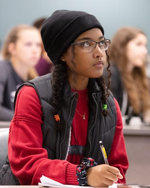Student listening to professor