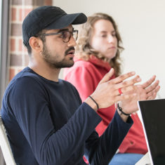 Male student talking in class