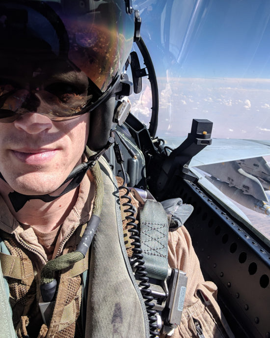 john tonkovich in the cockpit of a F/A-18 Super Hornet with sky in background