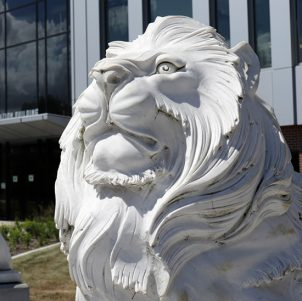 A lion sculpture outside PNW's Nils K Nelson Bioscience Innovation Building
