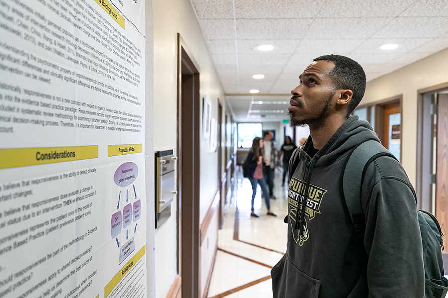 Tim Gilmore looking at a poster