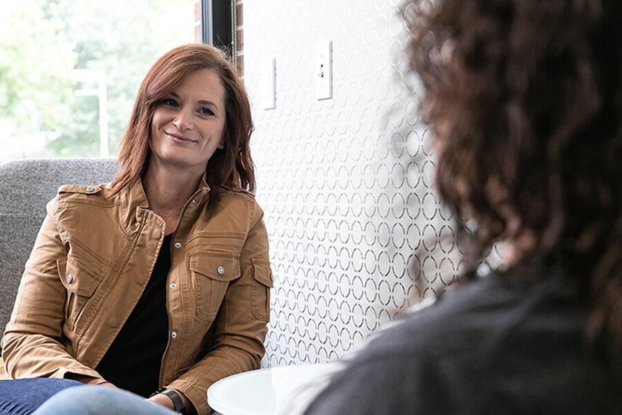 Two women sit in an office