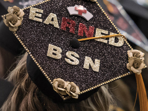 "A graduation cap decorated to read ""Earned BSN"""