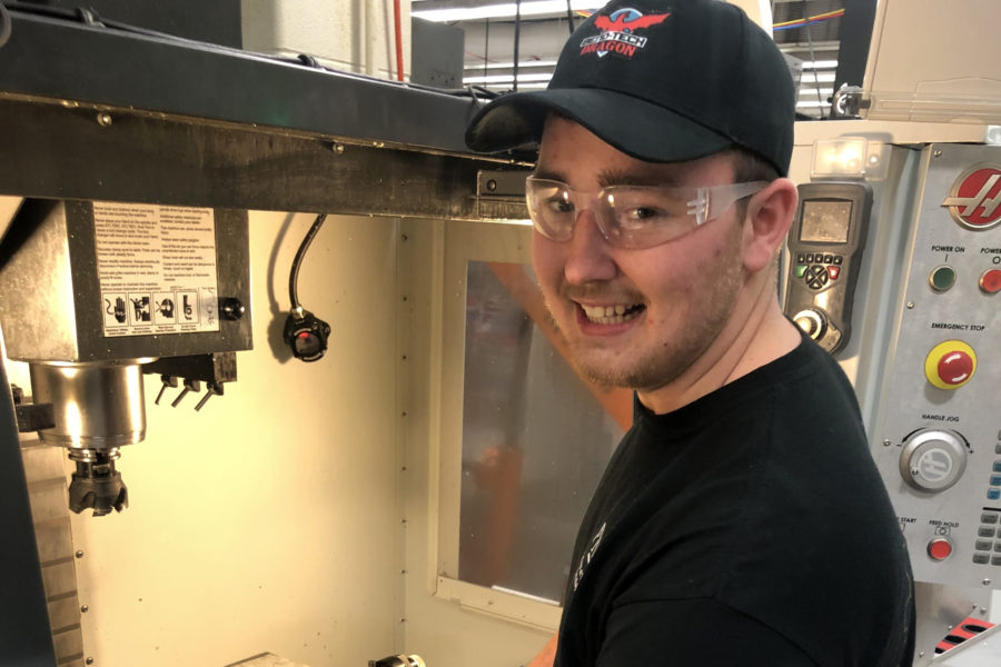 Student operating CNC machine