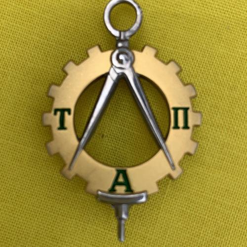 The Tau Alpha Pi pin