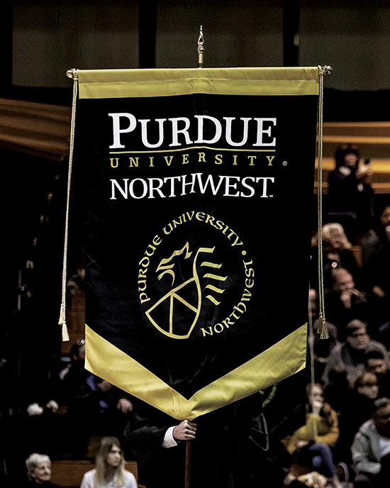 A Purdue University Northwest banner at graduation.