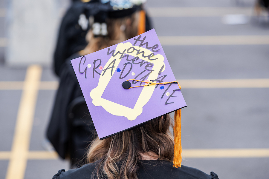 A decorated cap is pictured at commencement.