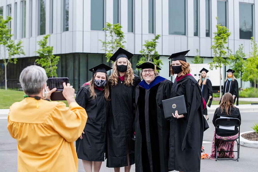 Grads posing for a pic at commencement.