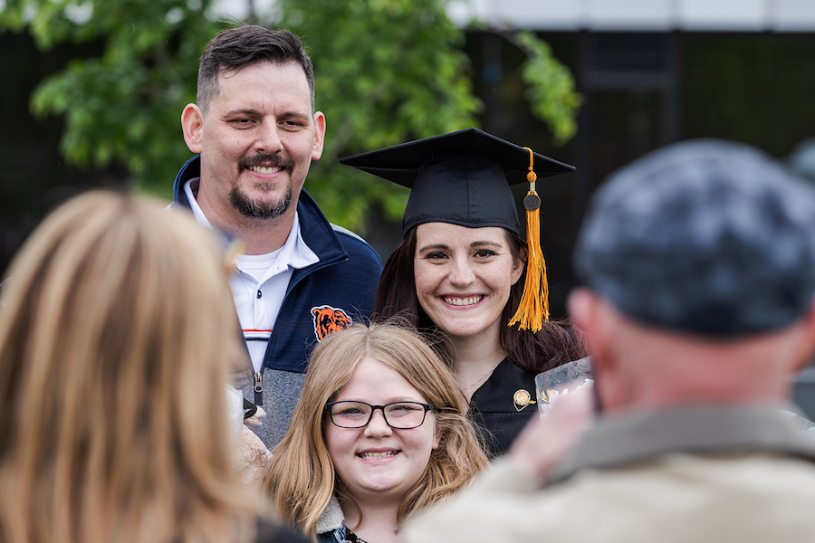 A grad and her family is pictured.