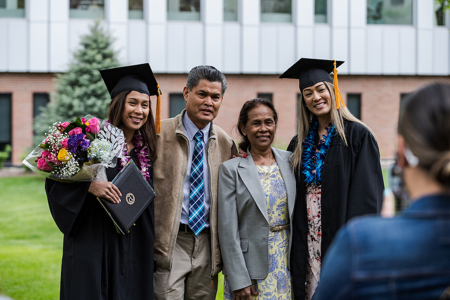 A family smiles at commencement ceremonies.
