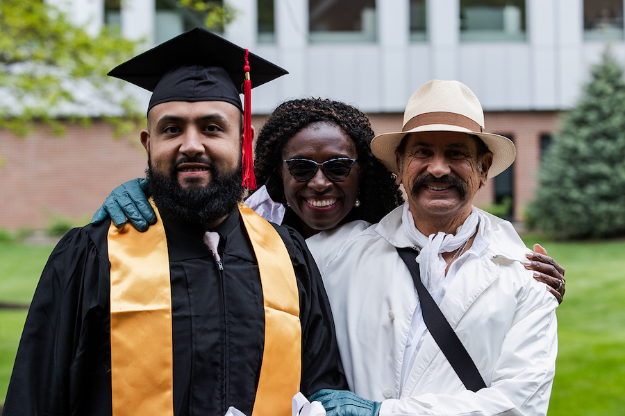 A family is pictured at graduation.