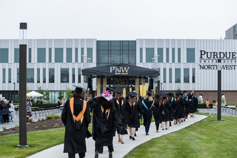 Students walking in commencement 2021.