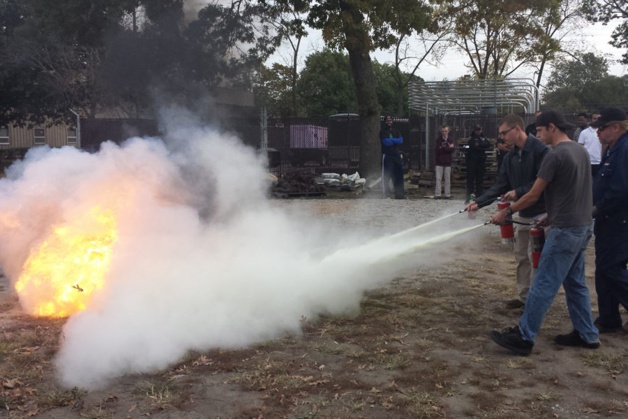 Feature 5 - EHS Students performing fire surpession techniques