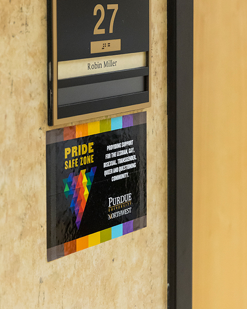 A pride safe zone sticker on a wall
