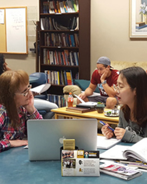 Student in the writing center getting help on a paper