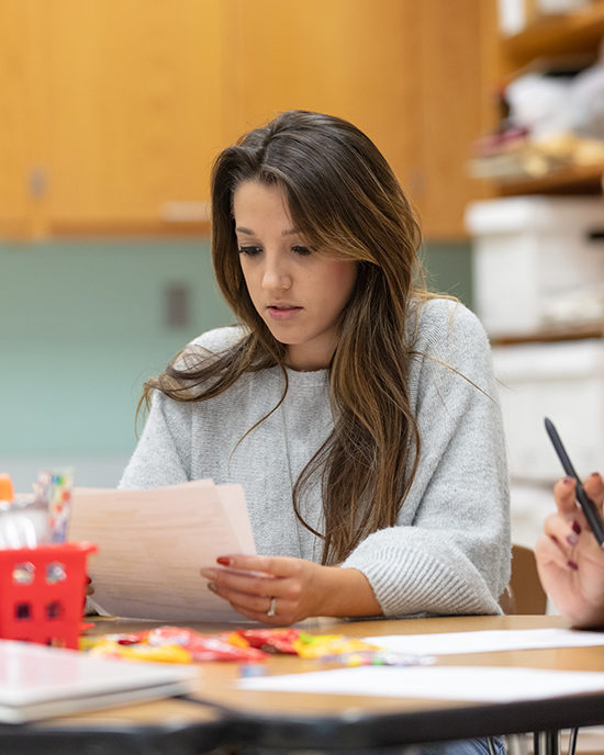 A student studies in a classroom