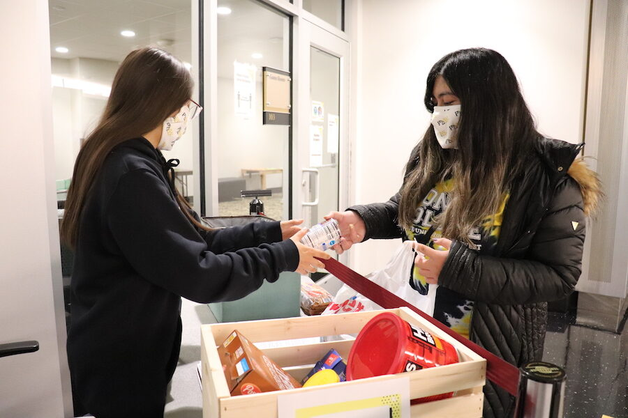 Students at the food pantry are pictured.