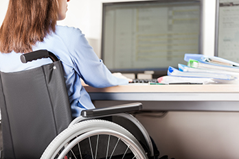 Student in a wheelchair using a computer