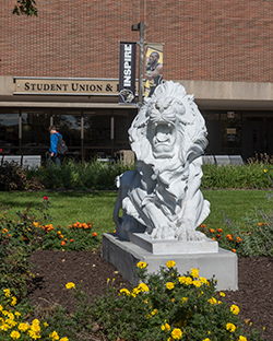 Lion Statue in front of the Student Union and Library Building