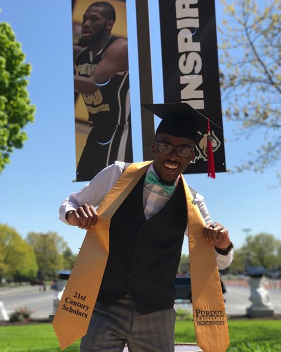 21st Century Scholar graduate posing with the sash