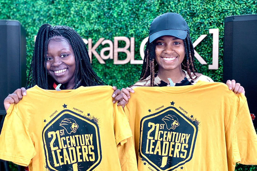 """Two participants in the 21st Century Scholars Summer Experience show off screenrpinted """"21st Century Leaders"""" t-shirts from Rockablock."""