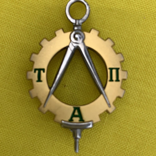 The Tau Alpha Pi pin