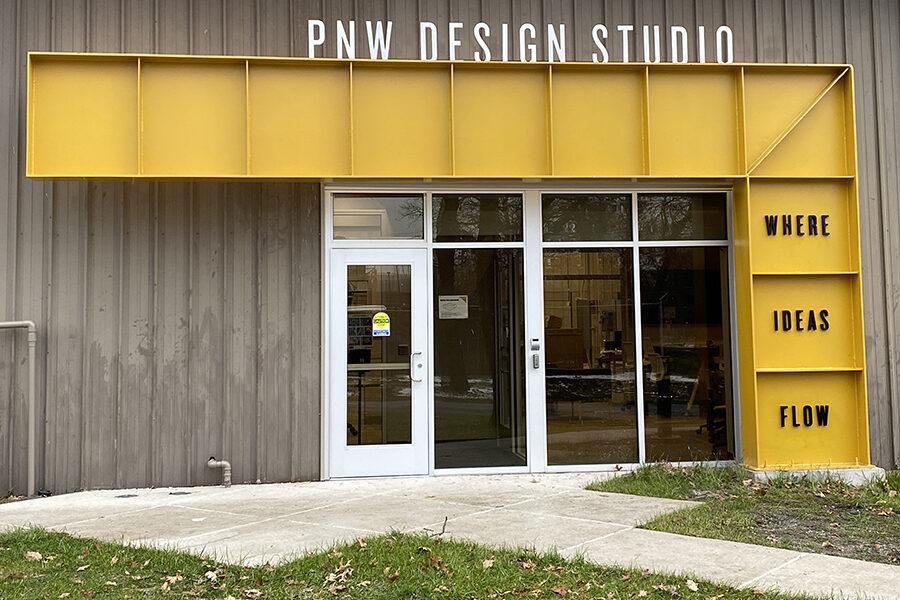 pnw design studio, where ideas flow. exterior signage on building entrance.