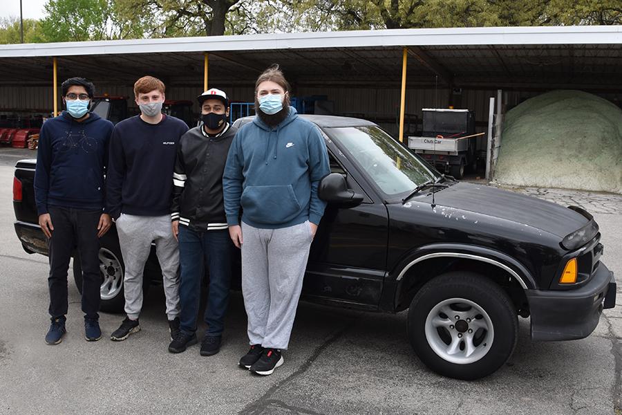 Senior Design spring '21 team of Ridwan Rahman, Jeffrey Osmulski, Mark Frost, Moises Picazzo with EV truck