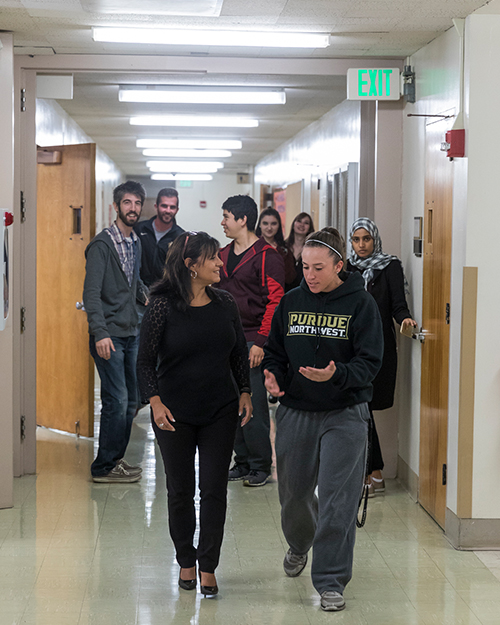 Students are walking down a hallway.