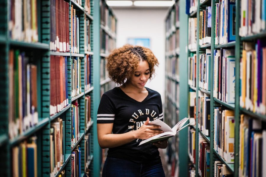 Student in library is pictured.
