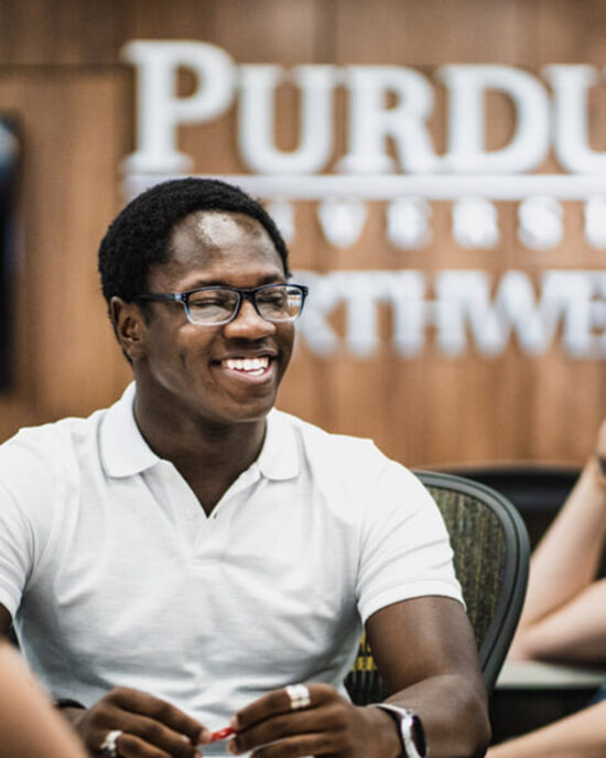 A PNW student smiles in the classroom