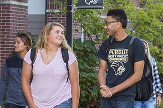 Students walking on campus are pictured.