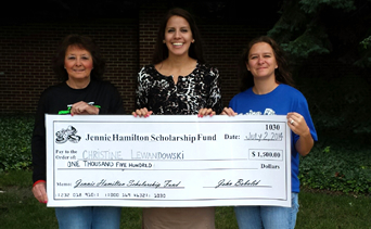 Students holding a Jennie Hamilton Scholarship check