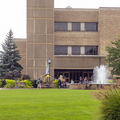 A fountain and building on PNW's Westville campus.