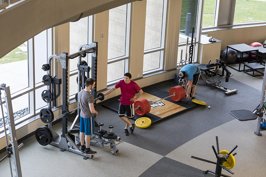 Students prepare to lift weights.