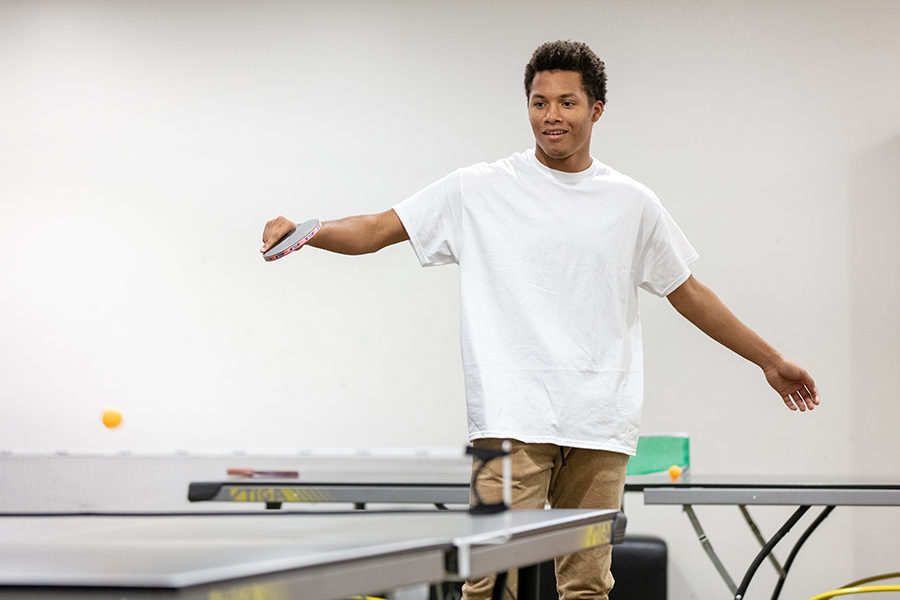 A student plays ping pong
