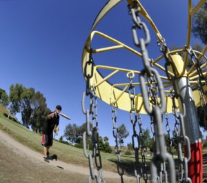 Image of people playing disc golf.
