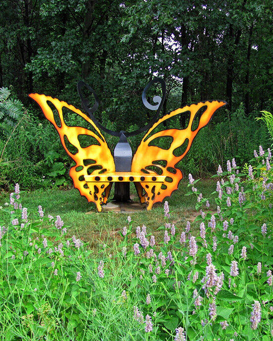 A butterfly sculpture in the native plant garden at Gabis Arboretum