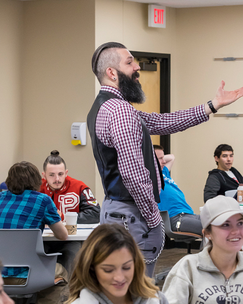 A faculty member in PNW's Department of History, Philosophy, Political Science and Economics teaches in the classroom