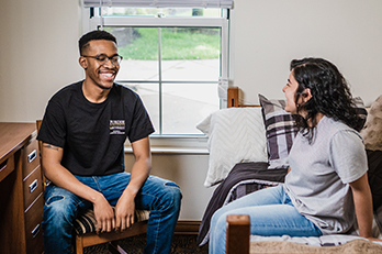 Students laugh in PNW housing