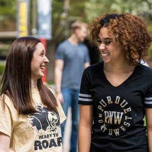 Two students walking are pictured.