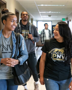 Purdue Northwest students walk down a hall