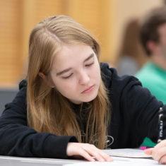 Female writing a paper