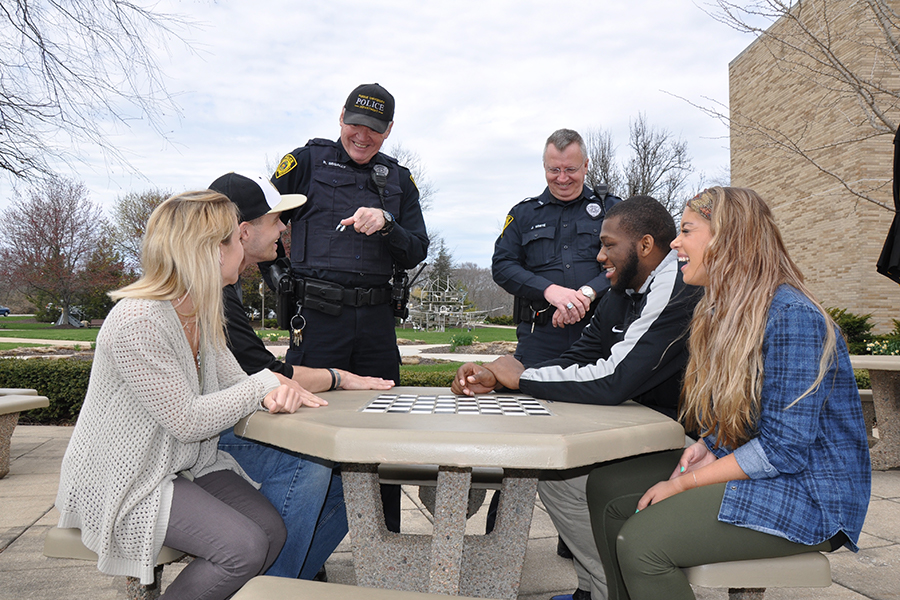 Police talking with PNW students