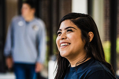 A student smiles on campus