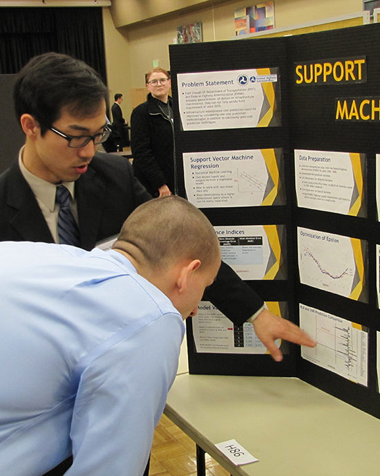 Student showing his research board