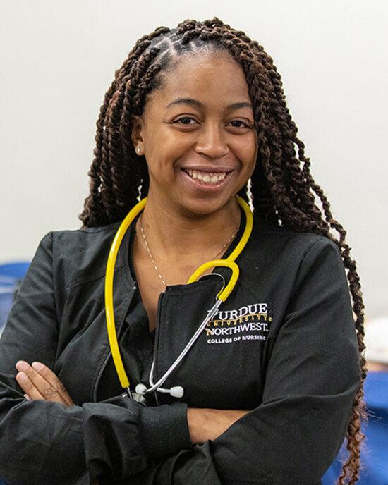 A PNW Nursing student wears a stethoscope